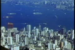 Hong Kong skyline and harbor from Victoria Peak 1984 - stock footage