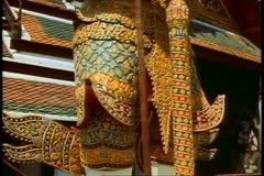 The Royal Palace of Bangkok, the classic image of a standing guard dragon Stock Footage