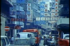 Hong Kong street scene, traffic, people, Chinese signs Stock Footage