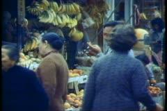 Hong Kong street market, bananas, man smoking, fish hanging Stock Footage