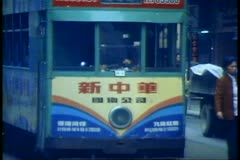 The Double decker trams of Hong Kong in Victoria on Hong Kong Island - stock footage
