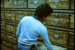 Stock Video Footage of A snake shop in Hong Kong, old wooden crates with snakes, a clerk sells them