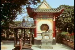The New Territories, Hong Kong, red and yellow structure, temple grounds Stock Footage