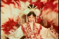 Hong Kong cultural show, dancers with red and white fans Stock Footage