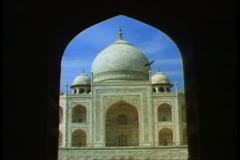 The Taj Mahal, Agra, India, close-up of the central dome framed in an archway Stock Footage