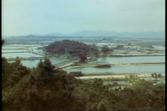 The New Territories, Hong Kong, overview to Red China, rice paddies Stock Footage
