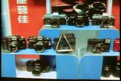 Hong Kong window shopping 1982, cameras Stock Footage