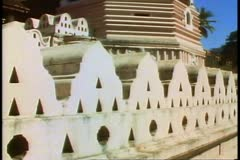 The Temple of the Tooth in Kandy, home of the tooth of Buddha in Sri Lanka Stock Footage