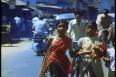 Crowds of people on a street in Madras, India - stock footage