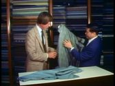 Stock Video Footage of Hong Kong Tailor, salesman and customer buying a custom tailored suit