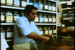 A Curry shop, clerk and customer, close-up mixing curries Durban, South Africa Stock Footage