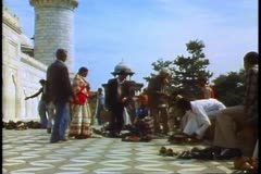 The Taj Mahal, Agra, India, people removing their shoes to enter Stock Footage