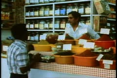 Stock Video Footage of A Curry shop with a clerk and a customer, Durban, South Africa