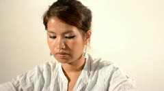Face of a Young Asian Woman Reading a Book Stock Footage