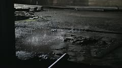 Water drops on concrete 4 Stock Footage