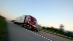 Semi 18 wheeler tracked as it passes by on the highway - stock footage
