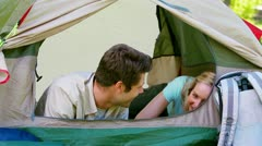 Couple in a tent looking outside Stock Footage