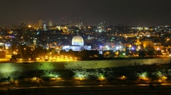 Skyline of Jerusalem Dome of the Rock at night time lapse pan Stock Footage