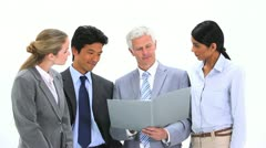 Manager showing a file to his team Stock Footage