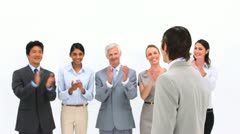 Man being congratulated by his co-workers - stock footage