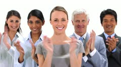 Business people applauding together - stock footage