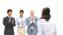 Brunette being applauded by her co-workers - stock footage