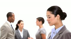 Businesswoman standing with co-workers behind her - stock footage