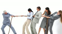 Business team playing Tug-of-War against their boss Stock Footage