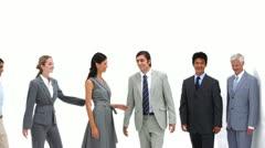 Business people standing shoulders to shoulders Stock Footage