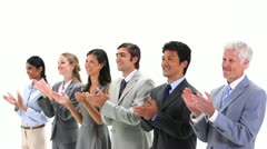 Business people standing side by side applauding - stock footage