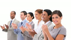 Well-dressed people applauding - stock footage