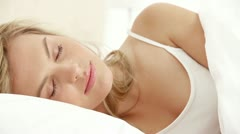 Peaceful woman going back to sleep Stock Footage