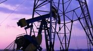 Stock Video Footage of Oil Derrick mechanism in the sunset