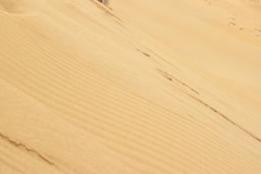Exhausted businessman climbing up dune in the desert Stock Footage