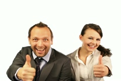 Excited businesspeople showing thumbs up, ok sign, isolated - stock footage