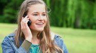 Joyful woman using a cellphone Stock Footage