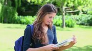 Happy young woman studying Stock Footage