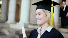 Smiling blonde student holding her diploma Stock Footage