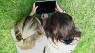 Happy friends using a tablet computer Stock Footage