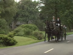 Friesian horse drawn carriage landauer towards camera Stock Footage