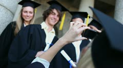 Smiling graduated students being photographed Stock Footage