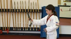 Young Girl practicing with martial arts batons Stock Footage