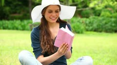 Smiling brunette holding a novel Stock Footage