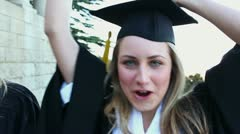 Graduated students raising their arms - stock footage