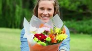 Happy woman holding a bunch of flowers Stock Footage
