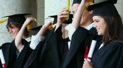 Happy students holding their tassels Stock Footage
