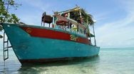 Colorful Boat on Belize Caye Stock Footage