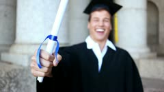 Happy student holding his diploma Stock Footage