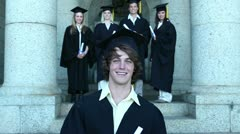 Graduates smiling as they pose - stock footage