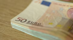 A bundle of money on the table selective focus Stock Footage